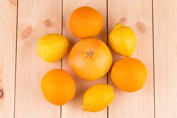 Close up of ripe oranges and grapefruits.