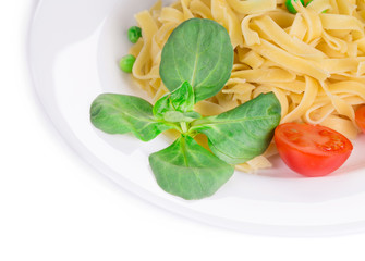 Tagliatelli pasta with tomatoes and basil.