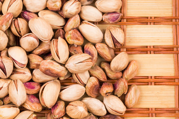 Close up of tasty pistachios on table.