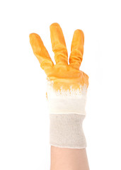 Gloved hand showing three fingers.