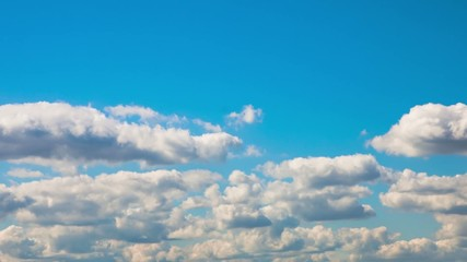 Blue sky with clouds closeup. Timelapse