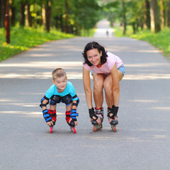 mother and son learn to roller skate.