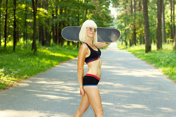 athletic sporty girl with skateboard