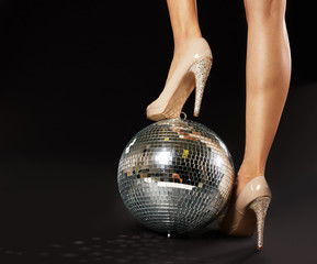 Woman's Foot Over Disco Ball