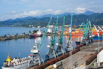 Ships, wagons and cranes in seaport