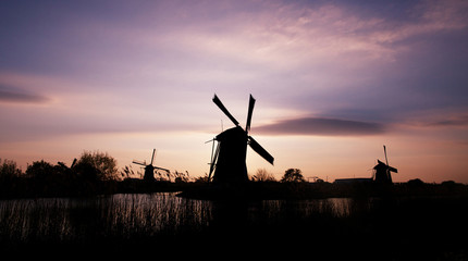 Dutch windmill at sunset at Kinderdijk in Netherlands
