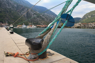 mooring bollard with knotted nautical ropes