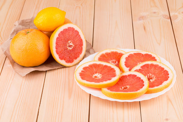 Grapefruit with slices on a wooden table
