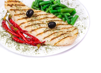 grilled salmon steak served of peas and red pepper
