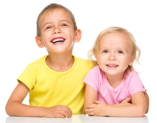 Portrait of a cute little girl and boy