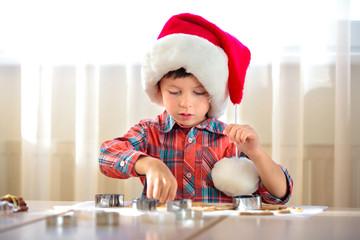 Little boy baking cookies, Merry Christmas