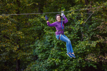Young woman having fun on long rope route