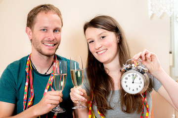 young couple having New Year's party