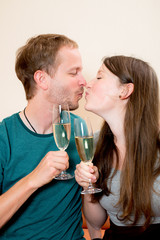 young couple having a party and kissing