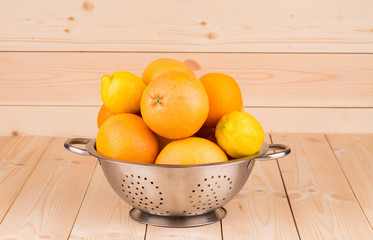 Grapefruits and lemons in a bowl