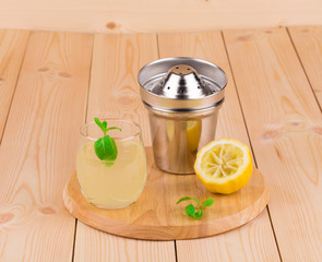 Summer lemonade on wooden background