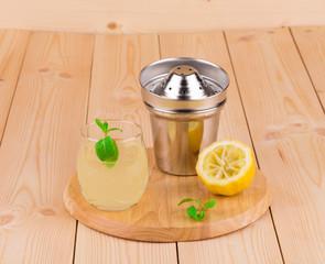 Summer lemonade on wooden background