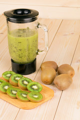 Kiwi smoothie on wooden background