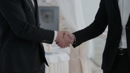 Handshake between city businessmen