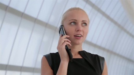 Woman is talking on cellular phone