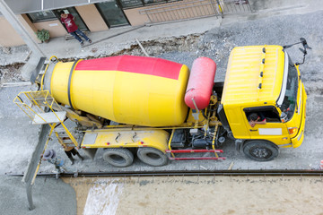 Construction worker pouring concrete from cement truck