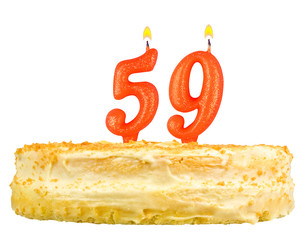 birthday cake with candles number fifty nine isolated on white
