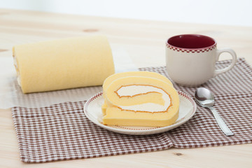 Rollcake with coffee cup