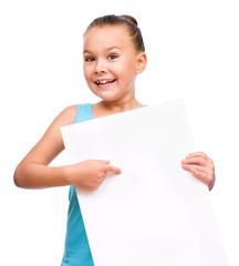 Little girl is holding blank banner