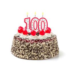 Geburtstagstorte mit brennender Kerze Nummer 100