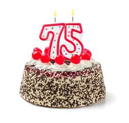 Geburtstagstorte mit brennender Kerze Nummer 75