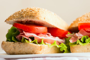 Prosciutto sandwich with tomato and arugula