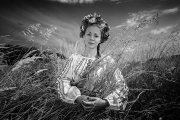 Monochrome portrait of national ukrainian woman in field