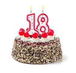 Geburtstagstorte mit brennender Kerze Nummer 18
