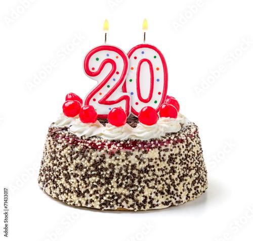 Geburtstagstorte mit brennender Kerze Nummer 20