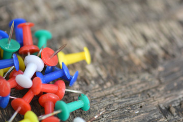 old push pins set on old wooden background
