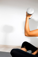 Woman exercising bicep curls with dumbbell