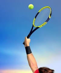 Man Making a Tennis Serve