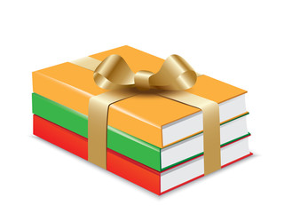 Books with gold ribbon and bow - isolated on white background