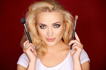 Female holding up makeup brush
