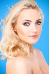 Blond female model wearing beautiful makeup