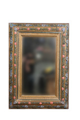 an old mirror in vintage frame