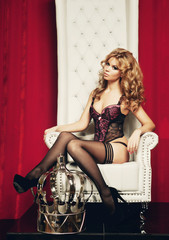 woman in lingerie sitting on throne