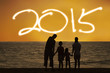 Family on beach enjoy new year 2015