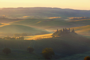 Sunrise over rural house  in San Quirico d'Orcia, Italy