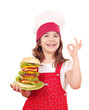 happy little girl cook with big hamburger and ok hand sign