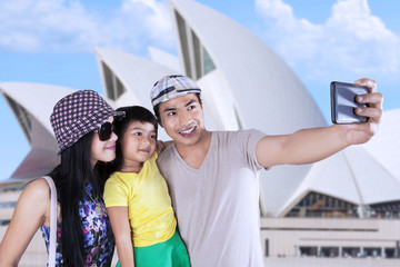 Happy family taking picture in sydney