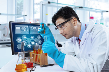 Hispanic scientist working in laboratory