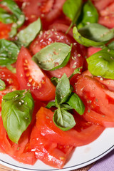 sliced of  tomatoes with basil,