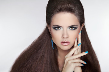 Beautiful Brunette young woman with fashion earring. Makeup.  Ma