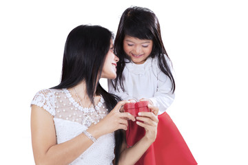 Lovely girl surprising her mother